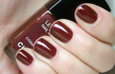 Cosmic Violine, a deep brick red infused with red, pink and gold micro glitter, is one of four nail polishes from Chanel's Celestial Lights (or Lumiéres Célestes) collection released back in 2009