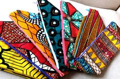 Loving the yellow pouche to the left African Inspired Fashion, African Print Fashion, African Theme, African Style, African Beauty, African Print Clothing, African Clothes, Ankara Bags, African Shop
