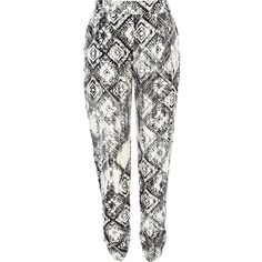 River Island Black and white tribal print trousers ($37) ❤ liked on Polyvore featuring pants, bottoms, perrie, trousers, calças, tapered pants, black and white tribal pants, white and black pants, tribal print pants and tapered trousers