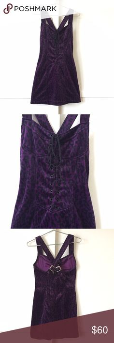"Lip Service Purple Faux Fur Goth Mini Dress The Animal Rescue Mini Dress by Lip Service. A special treat from the 90s archives of Hot Topic! This purple and black faux fur dress is to die for. Criss cross suspender style straps & lace up front are adjustable for added comfort. Pair with your favorite black fishnets and chunky heels for a sinfully good time! Made of polyester.   Chest: 32"" Waist: 28"" Length: 27""  Please check your measurements. There are no returns for clothing that doesn't…"