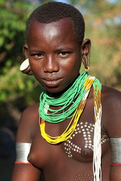 Ethiopia, tribes, Surma, Suri people Beautiful girl seen at the river in the village Tulgit.