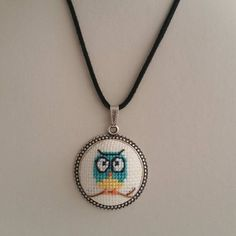 This cross stitch necklace is made of cotton thread,linen fabric and silver plated apparatus, You can wear the owl necklace to a party and look very special. Tiny Cross Stitch, Cross Stitch Designs, Cross Stitch Patterns, Cross Stitching, Cross Stitch Embroidery, Diamond Cross Necklaces, Owl Necklace, Owl Pendant, Le Point