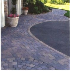 Residential Driveway Design ~ There's no steering around it. Your driveway plays a big role in your home's landscaping. http://parkerhomescape.com/residential-driveway-design/