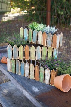 Kalalou Wooden Picket Fence Planters - Set Of 3 - Bring some Spring color to your garden or back porch with these rustic wooden picket fence boxes. Use them as planters or unique storage pieces for your gardening tools. The set includes one of each size. Color and finish will vary.