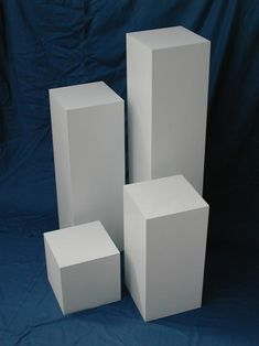 Glass-encased wall of pedestals for ceramic art.