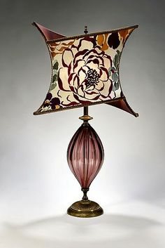 Tori: Caryn Kinzig and Susan Kinzig: Mixed-Media Table Lamp - Artful Home Large amethyst blown glass, criss-cross shade covered in bold embroidered dupioni in grape, fuschia, salmon and green colors. Uses one maximum bulb b Style Cottage, Unique Lamps, Modern Lamps, Design Blog, Bedroom Lamps, Bedroom Decor, Vintage Lamps, Lampshades, Desk Lamp