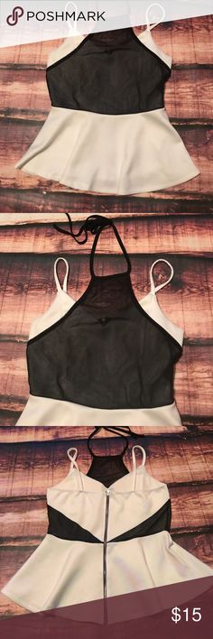 Mesh And White Peplum Tank Top This top is hot! Peplum style with built in cups. Mash Tie Up top, and mesh see-through panels on back. Has one small flaw as seen in picture but is not very noticeable. Charlotte Russe Tops Tank Tops