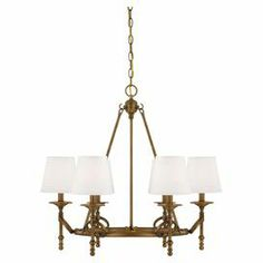 """Aged brass-finished chandelier with turned detailing and dupioni shades.  Product: ChandelierConstruction Material: Metal and dupioniColor: Aged brass and whiteAccommodates: (6) 60 Watt bulbs - not includedDimensions: 26"""" H x 27"""" Diameter"""