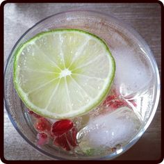 Pomegranate & Lime White Wine Spritzer... could this be the drink i drink all summer sitting out on our deck???