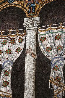 This mosaic in Basilica of Sant'Apollinare Nuovo in Ravenna has had images of the Arian king, Theoderic, and his court removed. However, on some columns their hands remain.
