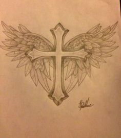 Cross with wings tattoo