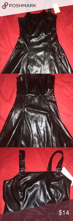 Black faux leather Jumper dress Sz Small Faux leather jumper dress with a side zip and adjustable straps. It has a fitted bodice with flare skirt. Dress is approx. 24 inches from top of bust to hem of skirt.  Never worn Tobi Dresses Mini