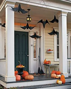 front porch halloween decorating with pumpkins hanging bats at martha stewart - Halloween Front Doors
