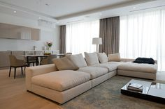 Apartments, Minimalist Living Room, Dining Room And Serving Kitchen With Matte White And Beige Tones: Lovely Minimalist Apartment Design