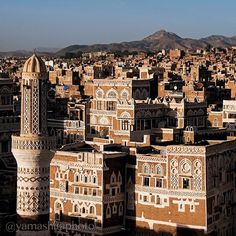Photo by Michael Yamashita. Inhabited for more than 2,500 years, Sana'a, the capital of Yemen, is one of the oldest continuously populated cities in the world. The city is noted for it's distinct architecture, featuring multi-story towers, strikingly decorated with geometric patterns