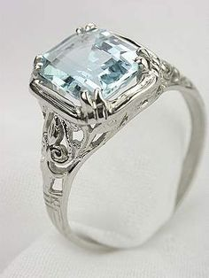 Emerald Cut Aquamarine Engagement Ring. Hate the ring but love the Aquamarine! The March Stone :)