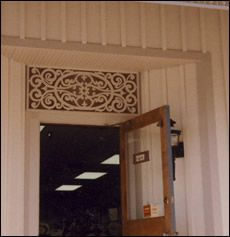 Queen Victorian Fretwork Panel in commercial building transom.