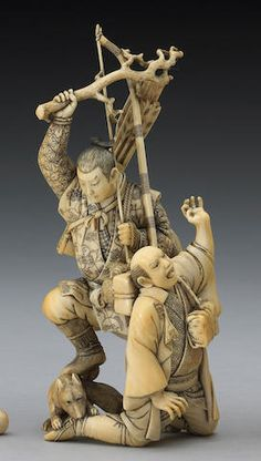 An ivory okimono figural group 19th Century, Signed Minzan