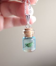 Items similar to sea turtle in a small bottle necklace on Etsy - Do you want a pet that you don& have to feed every day? Then this little guy is th - Bottle Jewelry, Bottle Charms, Bottle Necklace, Clay Charms, Collar Necklace, Cute Jewelry, Diy Jewelry, Jewelery, Jewelry Making