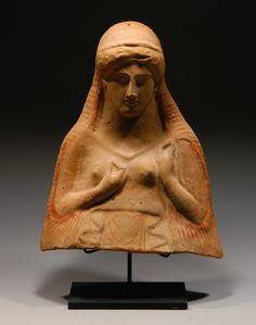 GREEK TERRACOTTA PROTOME BUST OF A GODDESS Probably Persephone, wearing peplos and himation; jewelry, garment folds and blond hair in red and yellow paint still visible. Ca. 470-450 BC. H. 10 1/4 in. (26.2 cm.) via > royalathena.com