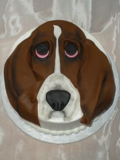 "Basset Hound Birthday Cake - I made this cake for my friend's dad who loves her new basset hound puppy. She wanted to surprise him for his birthday and didn't know what else to get him. This is an 8"" round. It is lemon with raspberry filling. It is done in white BC and the basset hound face is done in fondant."
