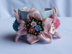 Items similar to Pastel Fabric Flower Cuff Statement Bracelet With Swarovski Crystal Detail -OOAK on Etsy Fabric Flowers, Swarovski Crystals, Pastel, Brooch, Trending Outfits, Unique Jewelry, Bracelets, Handmade Gifts, Pretty