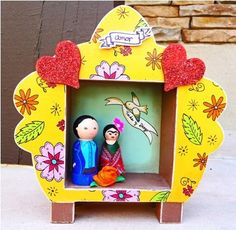Shrine art altar - Frida Kahlo and Diego Rivera wedding peg dolls. These would make great centerpieces!!