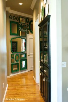Love the idea of using lots of mirrors painted the same color to create a statement wall.  Dimples and Tangles blog.