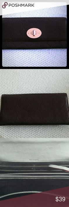 Kate Spade wallet Great wallet! 4 open sections, One zip coin holder and plenty of card slots too. Pebble leather with a lock twist closure. This has some scratches on the lock from opening and closing,  but other than that it looks new. kate spade Bags Wallets