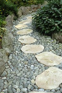 path with pebbles a great idea for a wet area to still allow water to flow with out getting your feet wet