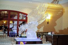Turning Stone Ice Sculpture - Flying Dragon Martini Luge with Blue Lighting