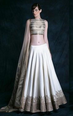 modern, edgy, metallic, crop top lehenga with white georgette lehenga skirt and gold border, sleeveless blouse and net dupatta Indian Attire, Indian Ethnic Wear, Indian Wedding Outfits, Indian Outfits, Wedding Attire, Wedding Dresses, India Fashion, Asian Fashion, Saris