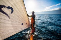 May 24, 2015. Leg 7 to Lisbon onboard Team Alvimedica. Day 07. Nick Dana looks to leeward from the end of the bowsprit during the morning's early hours. Nearing the centre of the Azores High the fleet scatters north-to-south while conditions become light and difficult - Amory Ross / Team Alvimedica / Volvo Ocean Race