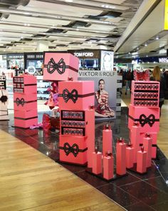 Viktor & Rolf creates excitement at Heathrow with new feminine fragrance, BONBON Window Display Retail, Cosmetic Display, Work Site, Flower Bomb, Viktor Rolf, Popup, Fragrances, Packaging Design, Product Launch
