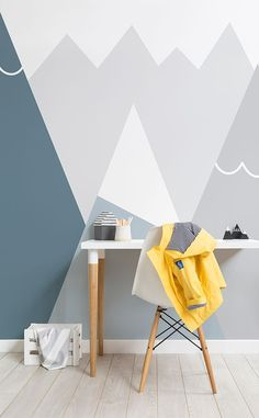 Here's one way of styling your kid's bedroom! This mountain wallpaper is beyond beautiful, showcasing sleek mountain silhouettes with dreamy hues of blue and gray. Perfect for children's play spaces and bedrooms.