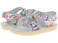 Salt Water Sandals: Sea Wee (Floral) Water-friendly leather upper has pretty heart cut-outs. Breathable leather lining and footbed. Two strap buckle closure ensures a secure fit. Brass buckles won't rust if you get them wet. Lightweight and flexible outsole.