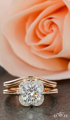 Floral engagement ring and band set in rose gold.