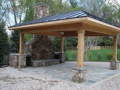 stonework accents this pergola for an outdoor seating area | deck ... - Patio Ideas With Fireplace