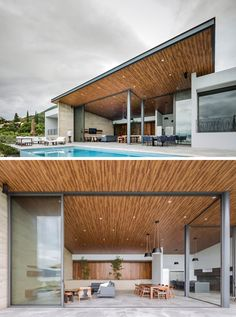 This modern house has large sliding glass walls that can be opened to create a true indoor / outdoor living environment, and the large overhanging wood ceiling flows seamlessly to the outside. #ModernHouse #ModernArchitecture #WoodCeiling #SlidingGlassWall