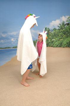 A Rainbow-Maned Unicorn Hooded Towel For Grownups