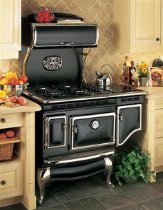 "VICTORIAN STOVEWORKS BLACK STOVE - All the charm of grandmother's but with every convenience... whatever your preference gas, electric or dual fuel we can create the appliance of your dreams. Ovens may be electric, convection or gas with a self-clean option. Griddles, a ""tendercook"" crockpot feature, a handpainted motif or an authentically cast silver Victorian trivet c.1880 graces the stove top."