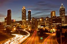 Downtown Atlanta skyline at night viewed from Jackson Street bridge. A famous view of the city featured in season 1 of The Walking Dead. Top Ten Places to Photograph in Atlanta | Way Into Atlanta
