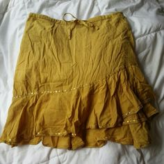 Mustard Gypsy Mini Skirt Tag says One Size but measures 15 inches flat. The front has holographic gold sequin detailing. 100% Cotton. Some stretch around the back of the waistband, but material is not stretchy. The front of the waistband has a tie. Made in India. Priced for bundling. Island Tropical Fashion Skirts Mini