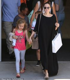 Not your average mom: Angelina Jolie wore a long black dress to take three of her six chil...