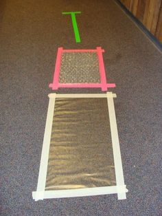 Contact paper, bubble wrap, and tape obstacle course from Ooey Gooey Lady!  We use painter's tape on the floor a lot for lots of things, so looking forward to a new twist on a great indoor winter-time large motor activity.