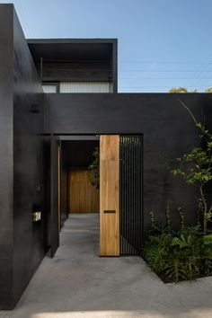 Lluvia House in Mexico City / Pérez Palacios Arquitectos Asociados - Retail Facade, Facade Lighting, Small Courtyards, México City, Ground Floor Plan, Black Exterior, Patio Doors, Black House, Facades