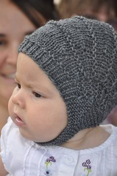 "Aviatrix is a fun, fast pattern for the cutest, best fitting baby helmet you will find. Worked on straight needles with instructions for 3 weights of yarn and 6 basic sizes this will become your ""go to"" last minute baby hat pattern, unassuming when it comes off the needles it needs to be placed on a baby's head to reveal it's true potential!"