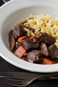 This beef stew recipe incorporates beef chuck roast, onions, garlic, thyme, bay leaves, porcini mushrooms, ruby port, tomato paste, bacon, celery, shiitake mushrooms and carrots to create the ultimate comfort food as a fall recipe. Whether you're looking to make this beef stew as a make ahead fall dinner recipe or as a game day food, it's a great choice for a fall recipe.#beefstewrecipes #beefstew #stewrecipes #souprecipes #comfortfoodrecipes #fallrecipes #gamedayfoods Cooking For A Group, Cooking Tips, Cooking Pork, Cooking Games, Wine Recipes, Beef Recipes, Food Trends, Pot Roast, Clean Eating Snacks