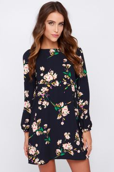 Feel and look bodaciously beautiful as soon as you slip into the Herbaceous Babe Navy Floral Print Shift Dress! A lightweight material in deep navy is strewn with a colorful floral print consisting of green, pink, white, purple, and orange. A flattering shift shape is topped off with a bateau neckline and puffed long sleeves with cuffs.