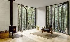 Partially supported by two trees, this contemporary cabin offers a quiet retreat from the city.